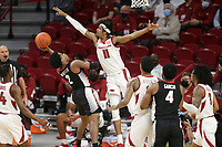 Arkansas guard Jalen Tate (11) blocks Georgia Sahvir Wheeler (2), Saturday, January 9, 2021 during the first half of a basketball game at Bud Walton Arena in Fayetteville. Check out nwaonline.com/210110Daily/ for today's photo gallery. <br /> (NWA Democrat-Gazette/Charlie Kaijo)