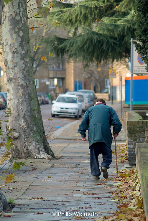An elderly man with a walking stick in Brent, North London