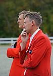 Boyd Martin (USA)  watches nervously the final rider Jan Byyny along Peter Akins (AUS), Boyd Wins the CCI 3* Dansko  at  Fair Hill International in Fair Hill, MD  on 10/16/11.  (Ryan Lasek / Eclipse Sportwire)