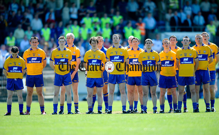 The Clare team stand for the anthem before their Munster Senior football championship game at Dungarvan. Photograph by John Kelly..