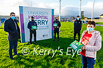 Jacky McCull Nurse Manager from the Children's Cashel Ward receiving the boxes from Kerry GAA  football and hurlers on Friday at the hospital. Front: Jacky McCull. Back l to r: David Moran, Oisin Maunsell, Jordan Conway and Colm Harty.
