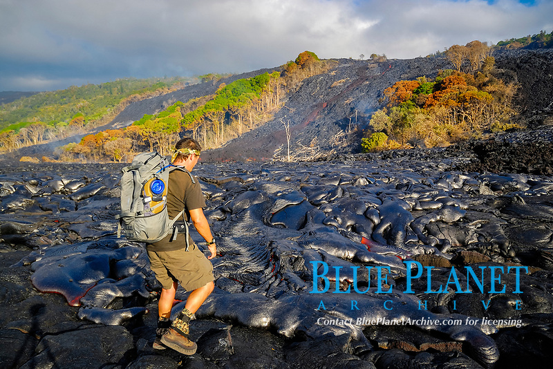 Self portrait, f-stop Tilopa camera backpack and a Camelback 70oz hydration bladder, Large Pahoehoe and A'a lava flows in Royal Gardens subdivision, Kilauea volcano, east of Hawaii, USA Volcanoes National Park, Big Island of Hawaii, USA