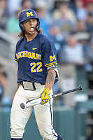 Michigan Wolverines outfielder Jordan Brewer (22) walks back to the dugout against the Vanderbilt Commodores during Game 3 of the NCAA College World Series Finals on June 26, 2019 at TD Ameritrade Park in Omaha, Nebraska. Vanderbilt defeated Michigan 8-2 to win the National Championship. (Andrew Woolley/Four Seam Images)