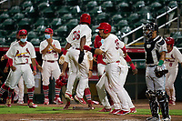 Palm Beach Cardinals, including Carlos Soto (35) and L.J. Jones (36), celebrate after a walk-off victory against the Daytona Tortugas on May 4, 2021 at Roger Dean Chevrolet Stadium in Jupiter, Florida.  (Mike Janes/Four Seam Images)