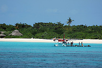 Passengers disembarking the seaplane on a floating wharf, Maldives.