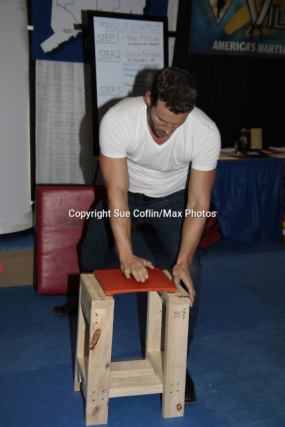 "Days of Our Lives Eric Martsolf ""Brady Black"" appears at the 12th Annual Comcast Women's Expo on September 7 (also 6th), 2014 at the Connecticut Convention Center, Hartford, CT. Eric visited the Villari's Windsor Studio - Martial Arts Centers' booth and broke some boards with Maggie and Ryan Farley.  (Photo by Sue Coflin/Max Photos)"