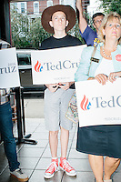 Blaise Notter (in brown hat), 14, of Merrimack, NH, listens as Texas senator and Republican presidential candidate Ted Cruz speaks to a crowd at a business round-table at the Draft Sports Bar and Grille in Concord, New Hampshire.