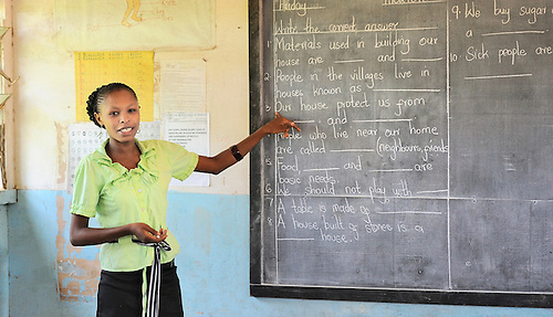 A teacher  at Likoni Hill Academy, an elementary school in Likoni, Kenya....