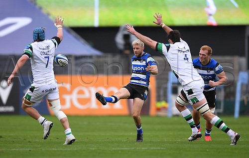 21st November 2020; Recreation Ground, Bath, Somerset, England; English Premiership Rugby, Bath versus Newcastle Falcons; Rhys Priestland of Bath kicks under pressure from Greg Peterson and Connor Collett of Newcastle Falcons