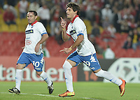 BOGOTÁ-COLOMBIA-11-02-2014. Alejandro Nicolas Martinez (Der), jugador de Nacional de Paraguay, celebra el gol anotado durante partido entre Independiente Santa Fe y Nacional de la segunda fase, grupo 4, de la Copa Bridgestone Libertadores en el estadio Nemesio Camacho El Campin, de la ciudad de Bogota./ Alejandro Nicolas Martinez (D) player of Nacional of Paraguay celebrates a goal scored during a match between Independiente Santa Fe and Nacional for the second phase, group 4, of the Copa Bridgestone Libertadores in the Nemesio Camacho El Campin in Bogota city.  Photo: VizzorImage/ Gabriel Aponte /Staff