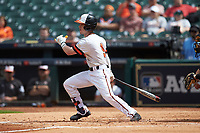 Trey Ochoa (9) of the Sam Houston State Bearkats follows through on his swing against the Vanderbilt Commodores in game one of the 2018 Shriners Hospitals for Children College Classic at Minute Maid Park on March 2, 2018 in Houston, Texas. The Bearkats walked-off the Commodores 7-6 in 10 innings.   (Brian Westerholt/Four Seam Images)