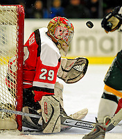3 January 2009: St. Lawrence Saints' goaltender Kain Tisi, a Junior from Mississauga, Ontario, makes a first period save against the University of Vermont Catamounts during the championship game of the Catamount Cup Ice Hockey Tournament at Gutterson Fieldhouse in Burlington, Vermont. The Cats defeated the Saints 4-0 and won the tournament for the second time since its inception in 2005...Mandatory Photo Credit: Ed Wolfstein Photo