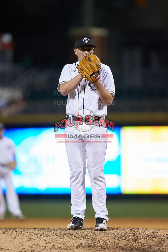 South Carolina Gamecocks relief pitcher Graham Lawson (13) looks to his catcher for the sign against the North Carolina Tar Heels at BB&T BallPark on April 3, 2018 in Charlotte, North Carolina. The Tar Heels defeated the Gamecocks 11-3. (Brian Westerholt/Four Seam Images)