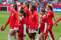 CARSON, CA - FEBRUARY 9: Rose Lavelle #16 and Crystal Dunn #19 of the United States walk onto the field during a game between Canada and USWNT at Dignity Health Sports Park on February 9, 2020 in Carson, California.