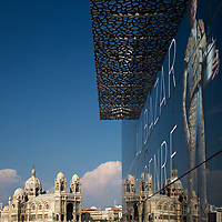 La Major cathedral reflecting on the modern Museum of European and Mediterranean Civilisations's (MUCEM) glass facade, Marseille waterfront, France