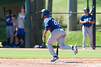 Los Angeles Dodgers outfielder Drew Avans (26) starts down the first base line during an Instructional League game against the Oakland Athletics at Camelback Ranch on September 27, 2018 in Glendale, Arizona. (Zachary Lucy/Four Seam Images)
