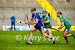 Cian Hussesy of St Brendan's about to strike for St Brendans goal as Crotta's Eamon Shanahan and Tomás O'Connor puts on the pressure, in the County Senior Hurling Championship quarter final