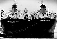 These lake carriers; wintered in Toronto harbor; will soon be plying the seaway. Officials see a good start but fear effects of a weak economy.<br /> <br /> Photo : Boris Spremo - Toronto Star archives - AQP