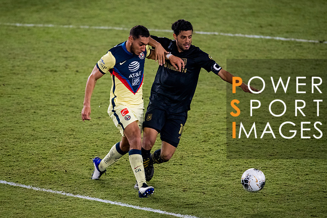 Carlos Vela of Los Angeles FC (USA) fights for the ball against Sebastian Caceres of Club America (MEX) during their CONCACAF Champions League Semi Finals match at the Orlando's Exploria Stadium on 19 December 2020, in Florida, USA. Photo by Victor Fraile / Power Sport Images