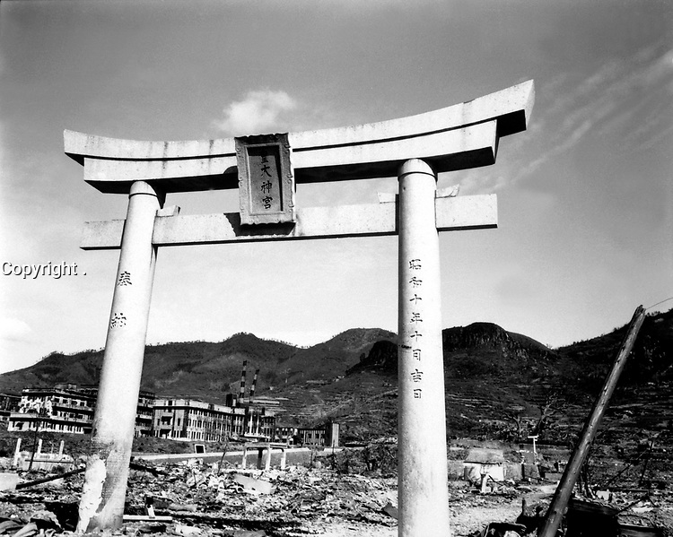 All that is left of one Shinto shrine in Nagasaki.  The arch is made of elements.  This plus the fact that the blast could go through and around the structure, enabled it to escape destruction.  Japan, October 1945.  Lt. R. J. Battersby.  (Marine Corps)<br /> Exact Date Shot Unknown<br /> NARA FILE #:  127-N-137017<br /> WAR & CONFLICT BOOK #:  1333