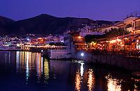 Greece. Crete. Hersonisos harbour. Waterfront Restaurants and Tavernas at night