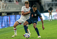 WASHINGTON, DC - SEPTEMBER 6: Maryland forward Hunter George (7) battles for the ball with Virginia midfielder Isaiah Byrd (3) during a game between University of Virginia and University of Maryland at Audi Field on September 6, 2021 in Washington, DC.