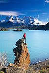 Hiker at eastern shore of Lake Pehoe looking toward Cuernos del Paine, Torres del Paine National Park, Chile