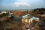 The remains of a small village five days after the Tsunami struck.This village was once home to over two hundred families.It now stands deserted.Akkaraipettai,Nagapattinam.India.