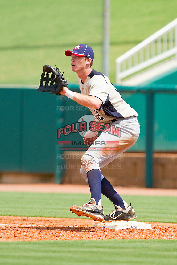 First baseman Zach Green #12 of PONY waits for a throw against Babe Ruth at the 2011 Tournament of Stars at the USA Baseball National Training Center on June 25, 2011 in Cary, North Carolina.  Babe Ruth defeated PONY by the score of 10-9. (Brian Westerholt/Four Seam Images)