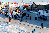 Aaron Burmeister's teams leaves the finish chute in Nome after he completed the 46th running of the Iditarod on Wednesday March 14th during the 2018 Iditarod Sled Dog Race.  <br /> <br /> Photo by Jeff Schultz/SchultzPhoto.com  (C) 2018  ALL RIGHTS RESERVED