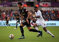 Mikel Merino of Newcastle United chased by Leroy Fer of Swansea City during the Premier League match between Swansea City and Newcastle United at The Liberty Stadium, Swansea, Wales, UK. Sunday 10 September 2017