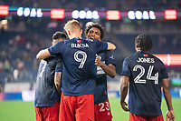 FOXBOROUGH, MA - MAY 22: DeJuan Jones #24 of New England Revolution celebrates with Adam Buksa #9 of New England Revolution during a game between New York Red Bulls and New England Revolution at Gillette Stadium on May 22, 2021 in Foxborough, Massachusetts.