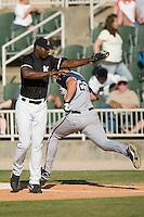 Kannapolis first baseman Chris Carter (33) fields an errant throw as Asheville center fielder Bret Berglund (25) stretches for first base at Fieldcrest Cannon Stadium in Kannapolis, NC, Sunday, April 29, 2007.