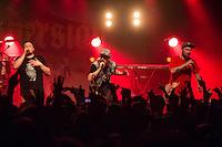 Die Hip-Hop-Gruppe Antilopen Gang aus Duesseldorf, Koeln und Berlin spielte am Samstag den 14. Maerz 2015 im ausverkauften Berliner Club SO36.<br /> Die Band besteht aus den Rappern Koljah Kolerikah (rechts), Panik Panzer (links) und Danger Dan (mitte) und steht beim Toten Hosen-Label JKP unter Vertrag.<br /> 14.3.2015, Berlin<br /> Copyright: Christian-Ditsch.de<br /> [Inhaltsveraendernde Manipulation des Fotos nur nach ausdruecklicher Genehmigung des Fotografen. Vereinbarungen ueber Abtretung von Persoenlichkeitsrechten/Model Release der abgebildeten Person/Personen liegen nicht vor. NO MODEL RELEASE! Nur fuer Redaktionelle Zwecke. Don't publish without copyright Christian-Ditsch.de, Veroeffentlichung nur mit Fotografennennung, sowie gegen Honorar, MwSt. und Beleg. Konto: I N G - D i B a, IBAN DE58500105175400192269, BIC INGDDEFFXXX, Kontakt: post@christian-ditsch.de<br /> Bei der Bearbeitung der Dateiinformationen darf die Urheberkennzeichnung in den EXIF- und  IPTC-Daten nicht entfernt werden, diese sind in digitalen Medien nach §95c UrhG rechtlich geschuetzt. Der Urhebervermerk wird gemaess §13 UrhG verlangt.]