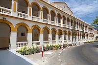 Dakar, Senegal.  Dakar Hospital.  Arches Line an Outdoor Corridor.