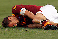 Calcio, Serie A: Roma vs Chievo Verona. Roma, stadio Olimpico, 7 maggio 2013..AS Roma forward Francesco Totti reacts after being injured during the Italian Serie A football match between AS Roma and ChievoVerona at Rome's Olympic stadium, 7 May 2013..UPDATE IMAGES PRESS/Riccardo De Luca