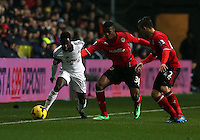Saturday, 08 February 2014<br /> Pictured L-R:  Nathan Dyer of Swansea against Wilfried Zaha and Declan John of Cardiff. <br /> Re: Barclay's Premier League, Swansea City FC v Cardiff City at the Liberty Stadium, south Wales, UK.