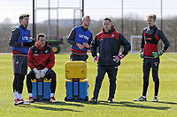 (L-R) Federico Fernandez, Erwin Mulder, Mike van der Hoorn, Tony Roberts, goalkeeping coach and Lewis Thomas rest during the Swansea City Training at The Fairwood Training Ground, Swansea, Wales, UK. Tuesday 13 March 2018