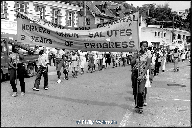 Workers with a trade union banner march through St.Georges to mark the third anniversary of the 1979 New Jewel Movement revolution.