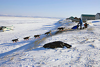 John Baker leaves the Shaktoolik checkpoint on Monday afternoon