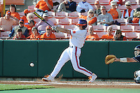 Right Fielder Joe Costigan #5 of the Clemson Tigers swings at a pitch during  a game against the North Carolina Tar Heels at Doug Kingsmore Stadium on March 9, 2012 in Clemson, South Carolina. The Tar Heels defeated the Tigers 4-3. Tony Farlow/Four Seam Images.