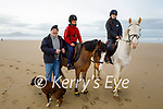 Michaela and Sandra Marshall with their horses on the beach in Banna on Sunday with their dad Mike Marshal and TK the dog.