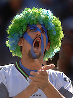 Sep 25, 2005; Seattle, WA, USA; A Seattle Seahawks fan cheers during the game against the Arizona Cardinals in the fourth quarter at Qwest Field. Mandatory Credit: Photo By Mark J. Rebilas