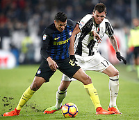 Calcio, Serie A: Torino, Juventus Stadium, 5 febbraio 2017.<br /> Inter Milan's Jeison Murillo (l) in action with Juventu's Mario Mandzukic (r) during the Italian Serie A football match between Juventus and Inter Milan at Turin's Juventus Stadium, on February 5, 2017.<br /> UPDATE IMAGES PRESS/Isabella Bonotto