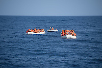 Sea Watch-2.<br /> Die Sea Watch-2 bei ihrer 13. SAR-Mission vor der libyschen Kueste.<br /> Im Bild: Ueberfuellte Schlauchboote mit je ca. 150 Gefluechteten. Sie trieben ueber Stunden orientierungslos herum, denn der Motor wurde ihnen von sog Engine-Fischern abgenommen. Die Crew der Sea Watch-2 versorgte sie ueber mehrere Stunden mit Wasser, bis sie von der italienischen Kuestenwache geborgen werden konnten.<br /> 22.10.2016, Mediterranean Sea<br /> Copyright: Christian-Ditsch.de<br /> [Inhaltsveraendernde Manipulation des Fotos nur nach ausdruecklicher Genehmigung des Fotografen. Vereinbarungen ueber Abtretung von Persoenlichkeitsrechten/Model Release der abgebildeten Person/Personen liegen nicht vor. NO MODEL RELEASE! Nur fuer Redaktionelle Zwecke. Don't publish without copyright Christian-Ditsch.de, Veroeffentlichung nur mit Fotografennennung, sowie gegen Honorar, MwSt. und Beleg. Konto: I N G - D i B a, IBAN DE58500105175400192269, BIC INGDDEFFXXX, Kontakt: post@christian-ditsch.de<br /> Bei der Bearbeitung der Dateiinformationen darf die Urheberkennzeichnung in den EXIF- und  IPTC-Daten nicht entfernt werden, diese sind in digitalen Medien nach §95c UrhG rechtlich geschuetzt. Der Urhebervermerk wird gemaess §13 UrhG verlangt.]