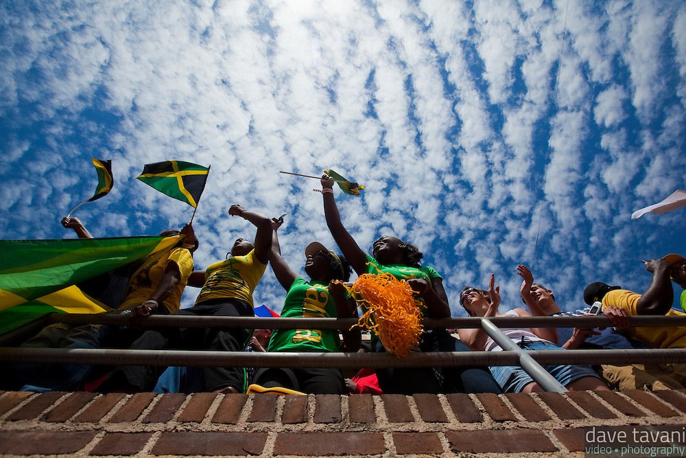A few Jamaican fans cheer as Usain Bolt anchors the Jamaica Gold 4x100 relay team to victory at the 2010 Penn Relays in Philadelphia.