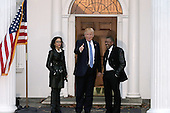Founder of BET Television, Robert Johnson (R) poses  with United States President-elect Donald Trump and an unidentified woman at the clubhouse of Trump International Golf Club, in Bedminster Township, New Jersey, USA, 20 November 2016.<br /> Credit: Peter Foley / Pool via CNP