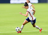 HOUSTON, TX - JUNE 10: Christen Press #23 of the United States brings the ball up the field during a game between Portugal and USWNT at BBVA Stadium on June 10, 2021 in Houston, Texas.