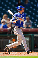 J.T. Riddle #10 of the Kentucky Wildcats follows through on his swing against the Utah Utes at Minute Maid Park on March 6, 2011 in Houston, Texas.  Photo by Brian Westerholt / Four Seam Images