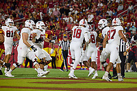 LOS ANGELES, CA - SEPTEMBER 11: The Stanford Cardinal offense celebrate after an 87 yard touchdown run by Nathaniel Peat #8 during a game between University of Southern California and Stanford Football at Los Angeles Memorial Coliseum on September 11, 2021 in Los Angeles, California.